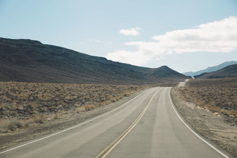 Arid Climate Arid Landscape Beauty In Nature Day Death Valley Death Valley National Park Desert Landscape Mountain Mountain Range Nature Nature No People Outdoors Road Road Road Marking Roadtrip Scenics Sky The Way Forward Tranquil Scene Tranquility Transportation White Line