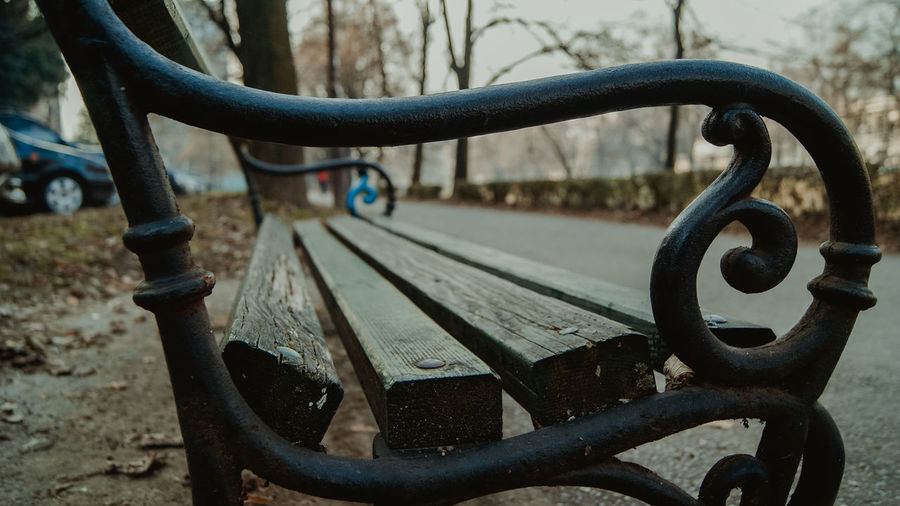 Close-up of metal bench in park