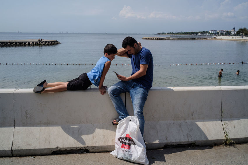 2018 Streetphotography Street Photography Streetphoto_color Streettogs Everybodystreet Human Condition Documentary Photography Social Documentary Sokakhikayeleri Summer In The City Friendship Bonding Togetherness Full Length Men Beach Sea Water