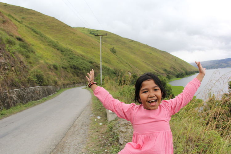 Happy Medan Sumatra  Toba Toba Lake Adult Arms Raised Cheerful Day Fun Gesturing Happiness Human Body Part Leisure Activity Lifestyles Looking At Camera Nature One Person Outdoors People Pink Color Portrait Samosir Smiling Standing Young Adult
