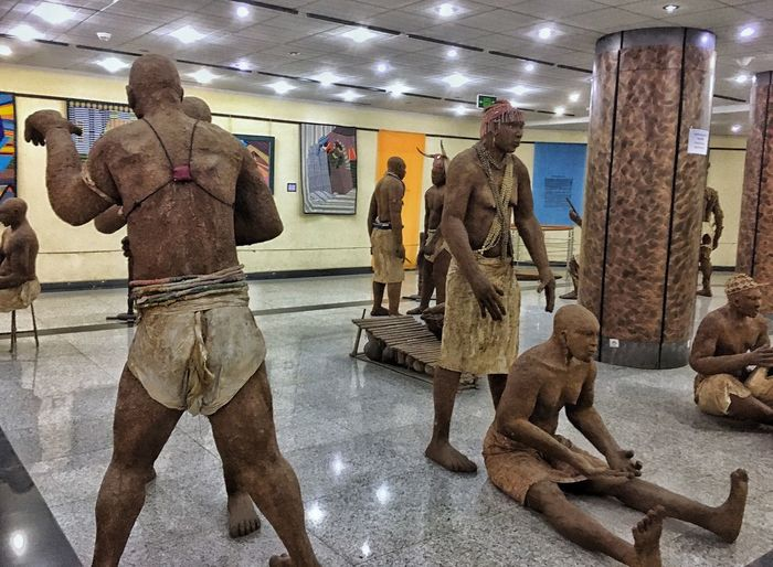Dakar Indoors  Representation Men Illuminated Real People Clothing Human Representation Reflection Mannequin People Adult Lifestyles Architecture Leisure Activity Store Incidental People Full Length Built Structure