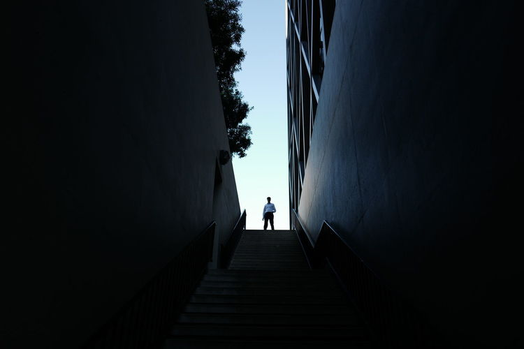 Low angle view of man standing at one maritime plaza in city