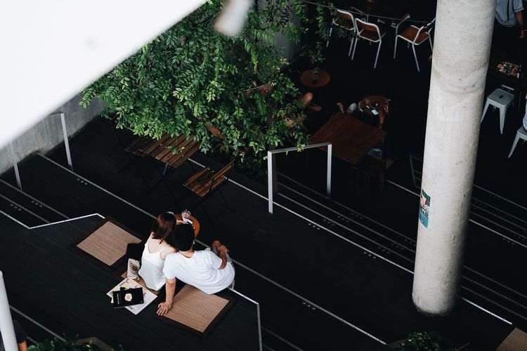 High angle view of couple sitting outdoors