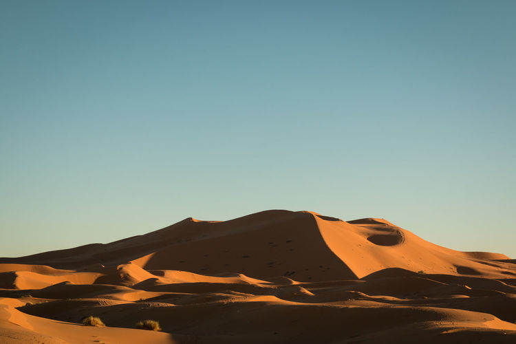 sand dune Arid Climate Atmospheric Beauty In Nature Blue Clear Sky Climate Copy Space Day Desert Environment Land Landscape Mountain Nature No People Non-urban Scene Outdoors Sand Scenics - Nature Sky Sunlight Tranquil Scene Tranquility Volcanic Crater