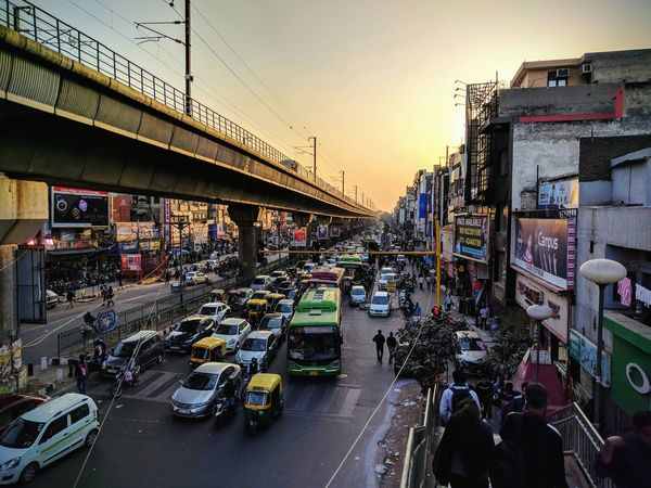 Sunset Evening in Metro City Delhi Sunset Evening  Sunset Sunset_collection Evening In The City Sunlight Nexus6P Car City Traffic City Street Sunset City Life Architecture Land Vehicle Cityscape Motorcycle Crowd People Sky Day