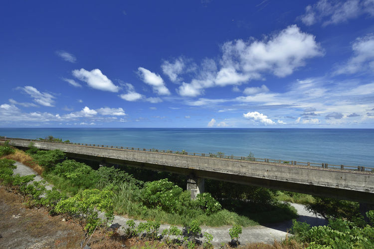 Train railroad Mercedes Benz in the blue sky and white clouds on the coast, with picturesque blue. Taiwan Architecture Beauty In Nature Blue Blue Sky Bridge - Man Made Structure Cloud - Sky Day Grass Growth Horizon Over Water Landscape Nature No People Outdoors Plant Railway Road Scenics Sea Sky Taitung Tranquil Scene Tranquility Water