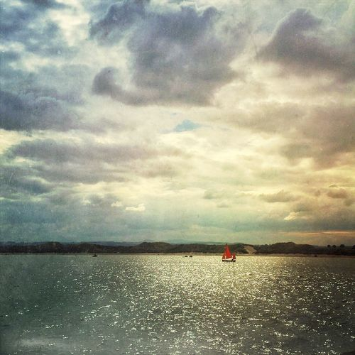 Small boat with red sails Sea Sky Sky And Clouds Clouds Painterly IPhoneography