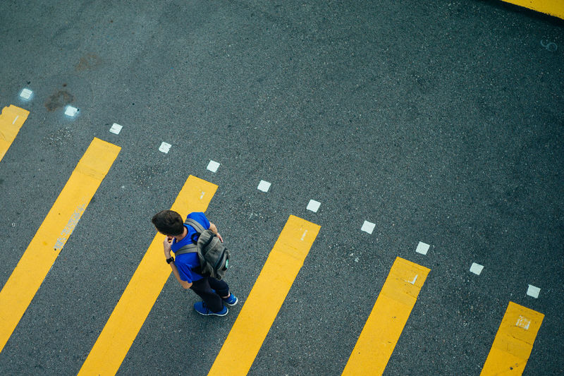 Road Road Marking High Angle View Marking Transportation City Symbol Sign Full Length Street One Person Men Crosswalk Yellow Crossing Day Zebra Crossing Safety Walking Outdoors