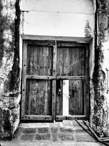 ENTRANCE is the main ATTRACTION monochrome photography Blackandwhite Fort Elgandalfort Door Closed Built Structure Architecture Entrance Day Safety Old EyeEmNewHere