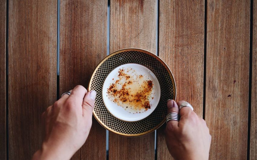Merken Human Hand Human Body Part Holding Personal Perspective Food And Drink Coffee - Drink Coffee Cup Food Table Wood - Material Directly Above One Person Mature Adult Gourmet Plate Indoors  Lifestyles Women Sweet Food Close-up
