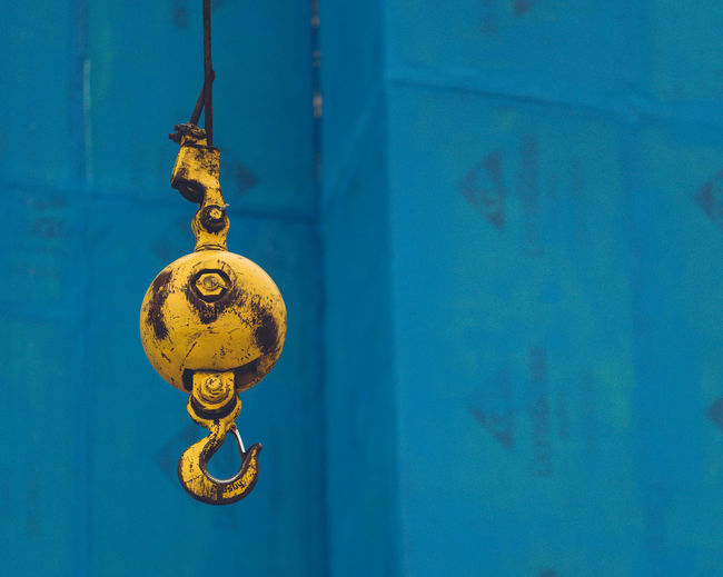 Blue Hanging No People Close-up Wall - Building Feature Metal Focus On Foreground Day Old Architecture Outdoors Yellow Shape Wall Hook Construction