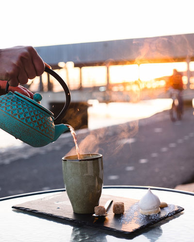 Human Hand Hand Food And Drink One Person Human Body Part Real People Cup Focus On Foreground Holding Drink Refreshment Mug Table Nature Close-up Coffee Coffee Cup Food Lifestyles Hot Drink Outdoors Tea Cup Finger Glass