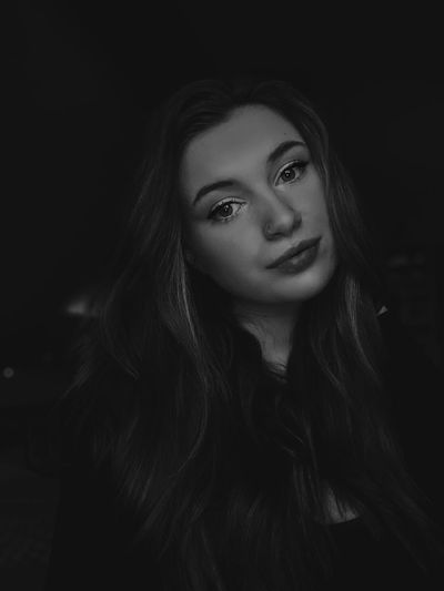 Portrait of smiling woman in darkroom