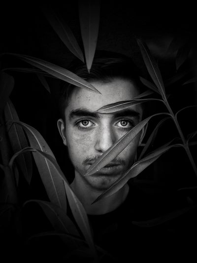 Eyes show the strength of the soul Portrait Black And White Blackandwhite Portrait Looking At Camera Headshot One Person Young Adult Front View The Portraitist - 2019 EyeEm Awards Adult Young Men Men Real People Indoors  Dark Close-up Black Background Human Body Part Leisure Activity Human Face