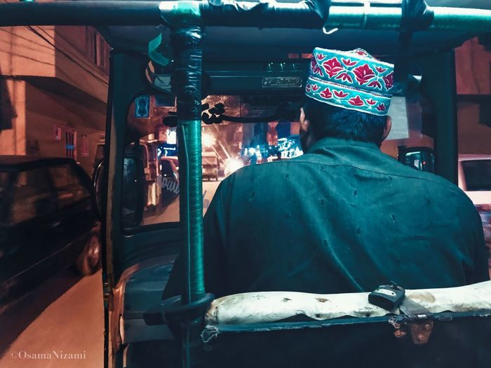 Rear view of people in bus