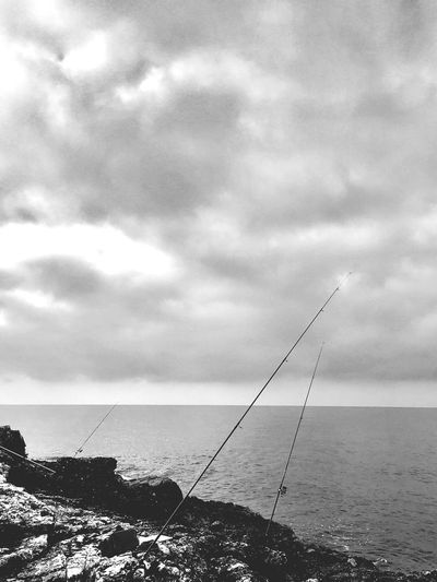Sea Horizon Over Water Water Tranquil Scene Sky Tranquility Cloud - Sky Fishing Pole Nature Outdoors Day Scenics Beauty In Nature No People Market Rockfishing