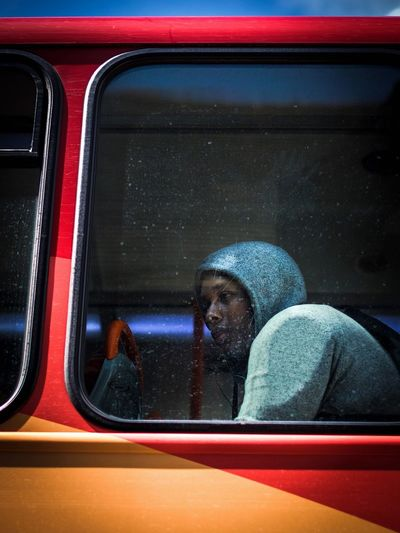 Top window Real People One Person Window Transportation Lifestyles Red Mode Of Transport Car Looking Through Window Headshot Land Vehicle Day Young Adult Outdoors Close-up People Bus Top Deck Windows Window View Streetphotography Street Photography