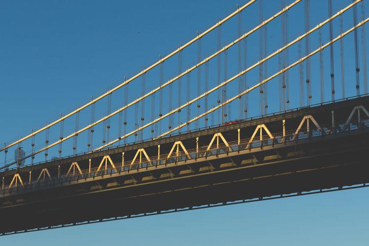 Low angle view of manhattan bridge at sunset