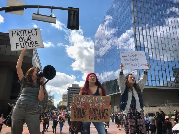 Our blood, your hands. USA Gun Control March For Our Lives Feminist Feminism Girl Teenagers  Girls Trump Rally Woman Protest Signs Text Western Script Communication Sky Group Of People Real People The Troublemakers Architecture Sign Day People The Street Photographer - 2018 EyeEm Awards The Photojournalist - 2018 EyeEm Awards