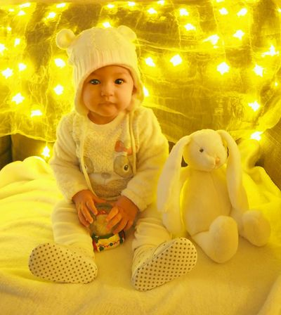 Baby Babies Only Cute Childhood One Person People Looking At Camera Indoors  Portrait Sitting Stuffed Toy Happiness Yellow Child Winter Smiling Wintertime Bunny  Toy Snow Ball