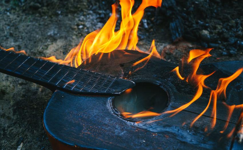 Close-up of bonfire on field