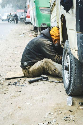 Sikh mechanic repairing truck
