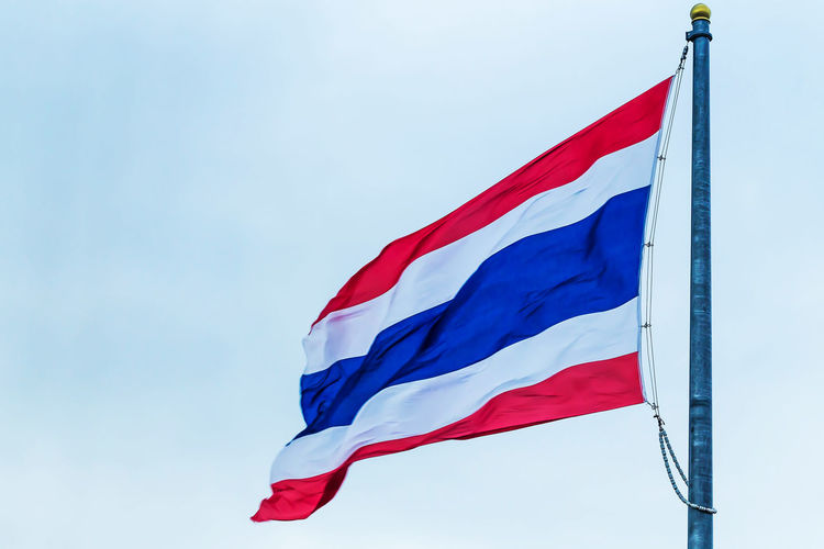 Low angle view of thai flag against clear sky