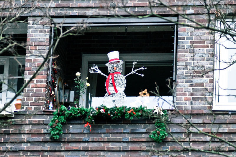 Low Angle View Of Snowman Decoration On Window