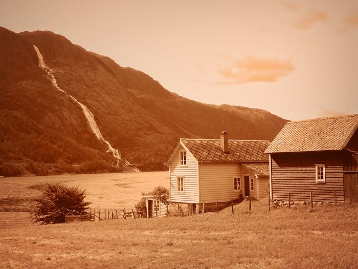 Norway Architecture Beauty In Nature Building Building Exterior Built Structure Cabin Cloud - Sky Cottage Environment House Hut Land Landscape Mountain Nature No People Outdoors Scenics - Nature Sepia Sky Tranquil Scene Tranquility Water