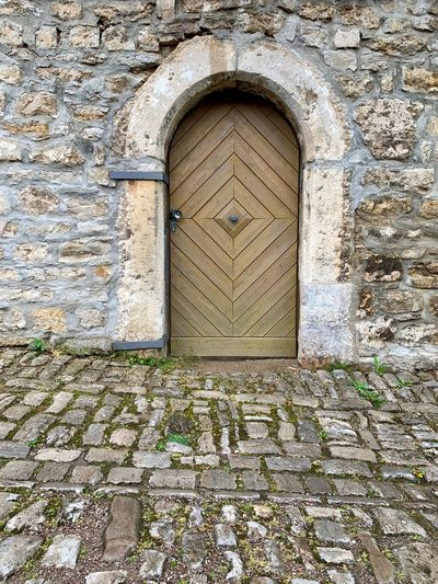 Architecture Door Entrance Built Structure Closed Day No People Security Building Exterior Protection Building Arch Safety Outdoors Wall - Building Feature Old Doorway Wall Nature Sunlight