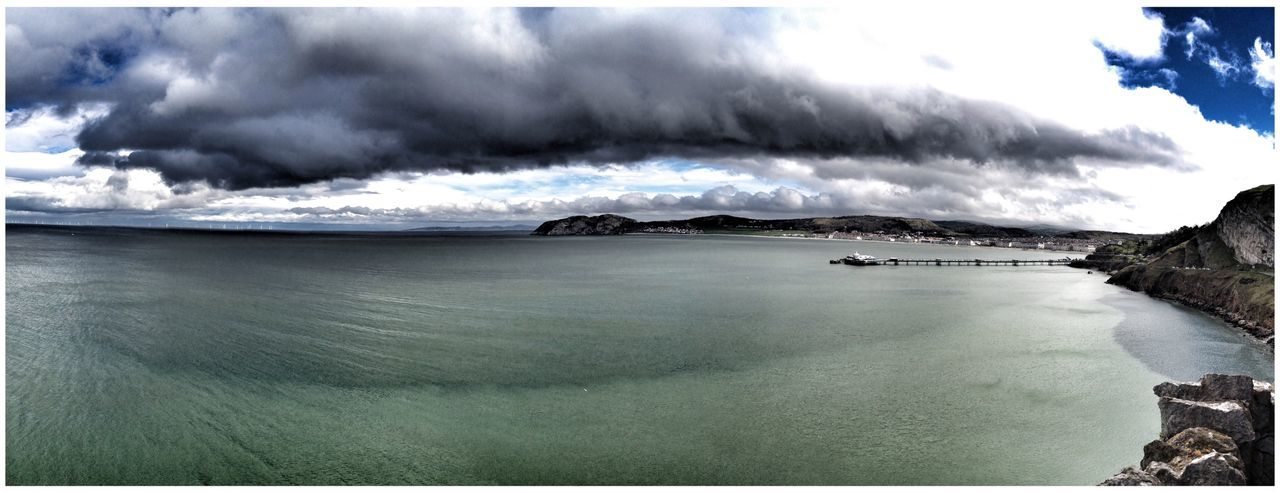 Panorama of Llandudno in North Wales with Pier Loved the Dark Cloud looming overhead with Reflection below. Panoramic Clouds And Sky Sea And Sky Seascape Water Water Reflections Water_collection Waves EyeEm Eye4photography  EyeEm Gallery Eyemphotography Great Orme