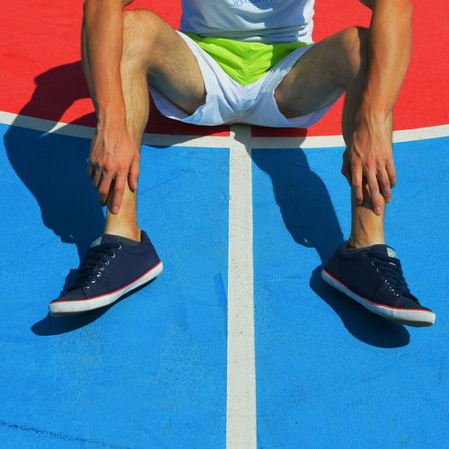 Athleisure Blue Casual Clothing Close-up Footwear Human Foot Leisure Activity Lifestyles Man Part Of Person Sitting Sneakers Eyeemphoto The Color Of Sport Exploring Style The Photojournalist - 2017 EyeEm Awards Out Of The Box