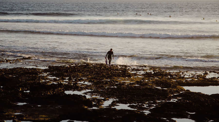 Man Wading In Sea