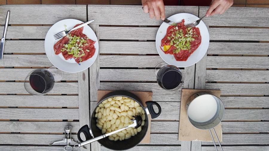 Bowl Breakfast Carpaccio Chopsticks Dinner Directly Above Eating Food Freshness Friends Gnocchi Indulgence Leisure Activity Lifestyles Lunch Meal Part Of Ready-to-eat Refreshment Serving Size Still Life Togetherness Unrecognizable Person Wood - Material Wooden