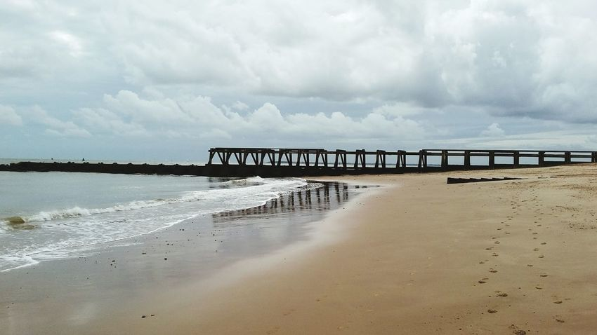 Water Beach Built Structure Connection Architecture Sea Cloudy Shore Sky Sand Cloud - Sky Bridge - Man Made Structure Scenics Wave Nature Tranquil Scene Cloud Beauty In Nature
