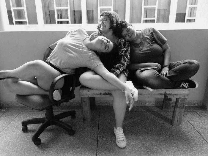 Young Women Friendship Full Length City Togetherness Sitting Women Bonding Couple - Relationship Abdomen
