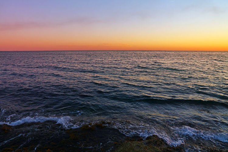 Sunset sky over rippled sea Beauty In Nature Horizon Over Water Sea Sky Water Sunset Horizon Scenics - Nature Nature Wave Tranquility No People Seascape Tranquil Scene Orange Color Idyllic Dusk Outdoors Summer Copy Space Surf