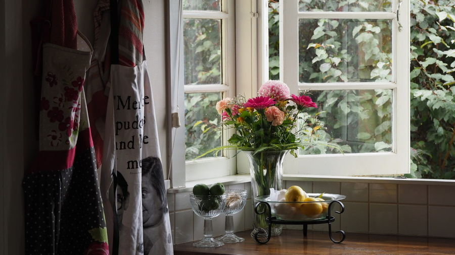 Flower Vase On Window Sill