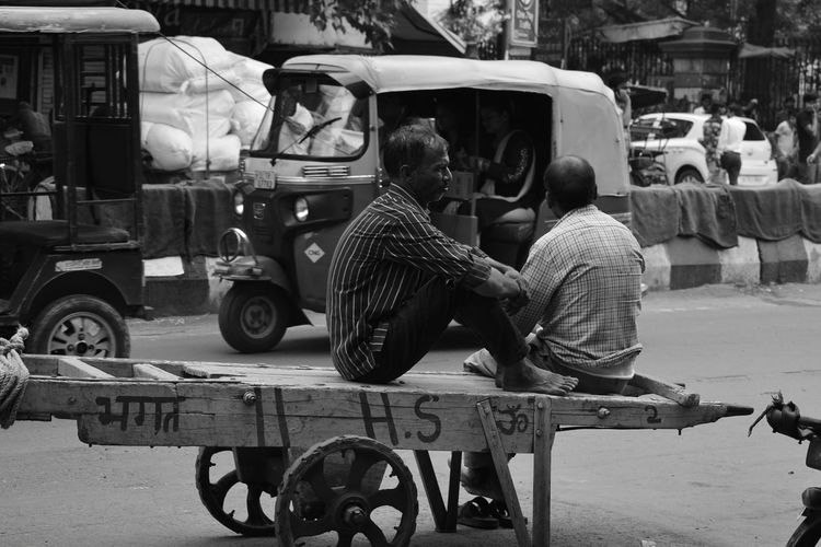 Outdoors Real People Sitting One Person Adult Day People Lifestyles Streetphotography Photographeratwork Photography Poorpeople Togetherness Chandnichowk Photographer Povertyofindia Hard Small Business Poverty_moments Lives Poverty Lives. Poverty Street Chandni Chowk Full Length
