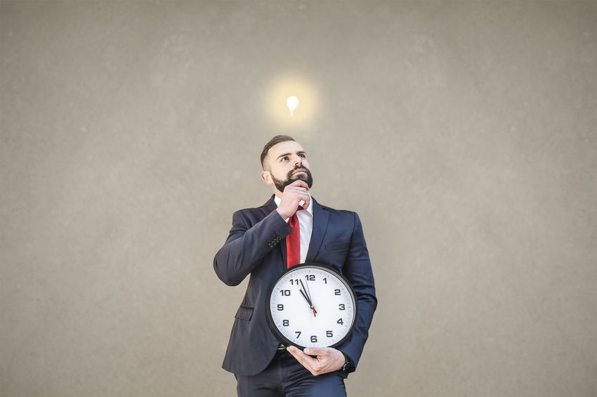 Model: Roberto Materiale Business Business Person Businessman Clock Copy Space Front View Holding Indoors  Males  Men Mid Adult Mouth Open One Person Standing Studio Shot Three Quarter Length Time Wall - Building Feature Well-dressed