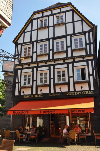 Generic Architecture Half-timbered House Fachwerkhaus Germany Building Exterior Architecture Built Structure Text Outdoors City Communication Cafe Day