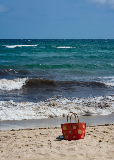 Can Picafort (Balearic Island) Mallorca Red Bag Bag Beach Beauty In Nature Day Horizon Horizon Over Water Land Motion Nature No People Outdoors Sand Scenics - Nature Sea Sky Water Wave