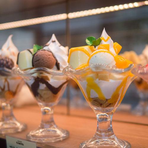 Close-up of ice cream sundaes on table