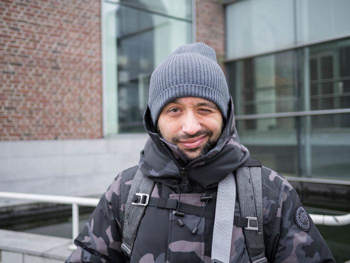 Portrait of man wearing hat standing in winter