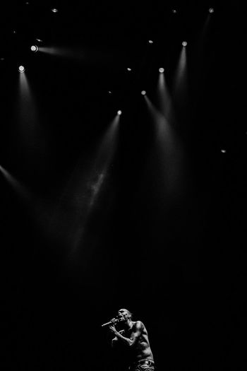 Person standing in the dark