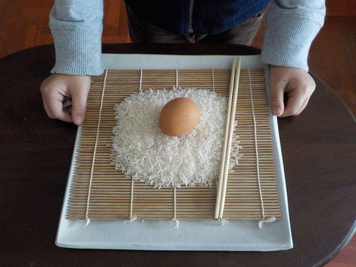 little boy's hands holding fresh staff to cook Food And Drink Food Real People Freshness Holding Indoors  Human Hand Human Body Part Egg Wellbeing One Person Hand Healthy Eating Midsection High Angle View Table Unrecognizable Person Lifestyles Preparation  Preparing Food Egg Yolk Finger