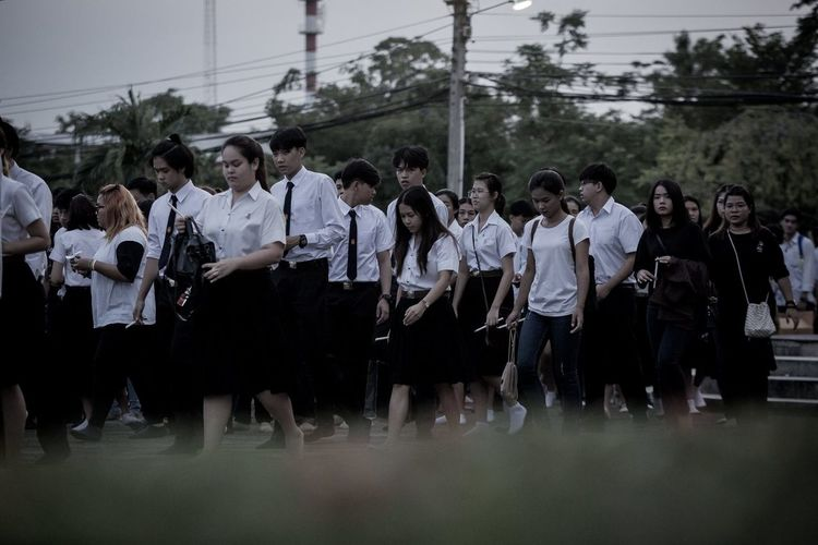 RAMA9 I Love King Sad Day Students Thailand Casual Clothing Day Field Full Length Large Group Of People Men Nature Outdoors People Real People Standing Togetherness Tree Women