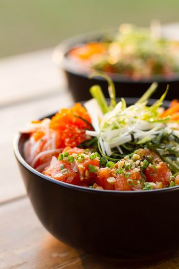 Close-up of poke in bowls