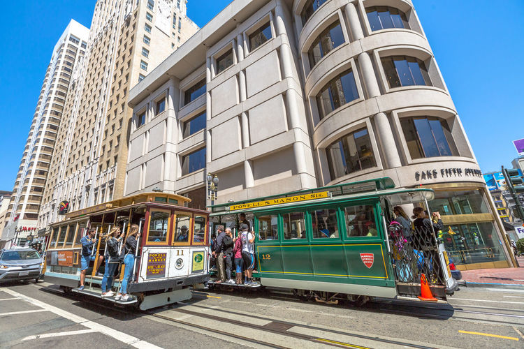 San Francisco, CA, United States - August 17, 2016: crowds of tourists in the popular Union Square, the central square of San Francisco on Market Street, known as the place shopping and luxury hotels. San Francisco, California, United States - August 17, 2016: the Big Bus, Hop On Hop Off, Sightseeing Tour, the popular double-decker bus carrying tourists, standing in Union Square, during a day tour. Cable Car California Market SF San Francisco Square Union Union Square SF United States Adult Architecture Building Exterior City Day Group Of People Large Group Of People Market Street San Francisco Market Street Men Mode Of Transport Outdoors People Public Transportation Rail Transportation Railroad Track Real People Sky Street Train - Vehicle Transportation Union Square  Unionsquare Women