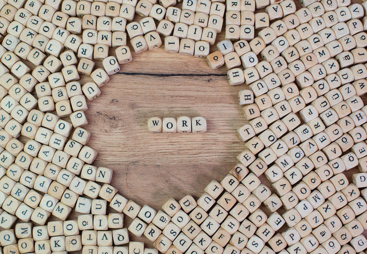 Directly Above Shot Of Work Text Amidst Wooden Cubes